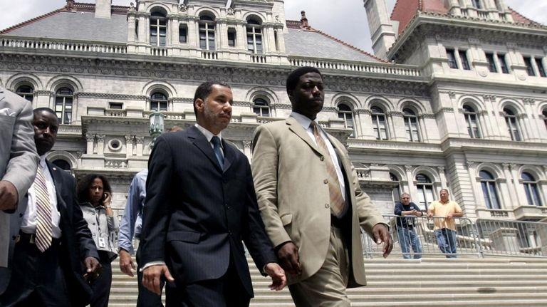 Gov. David Paterson, left, with David Johnson, a