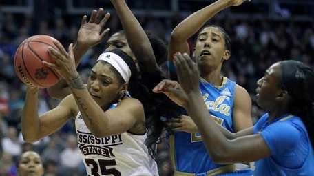 Mississippi State guard Victoria Vivians (35) rebounds against
