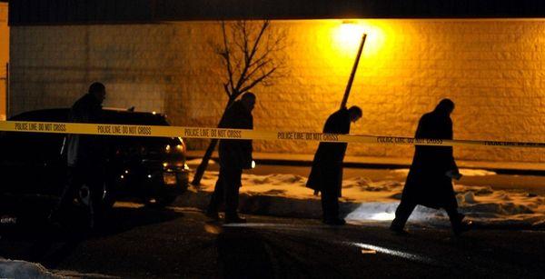 Police investigate the scene where David Sandler, 20,