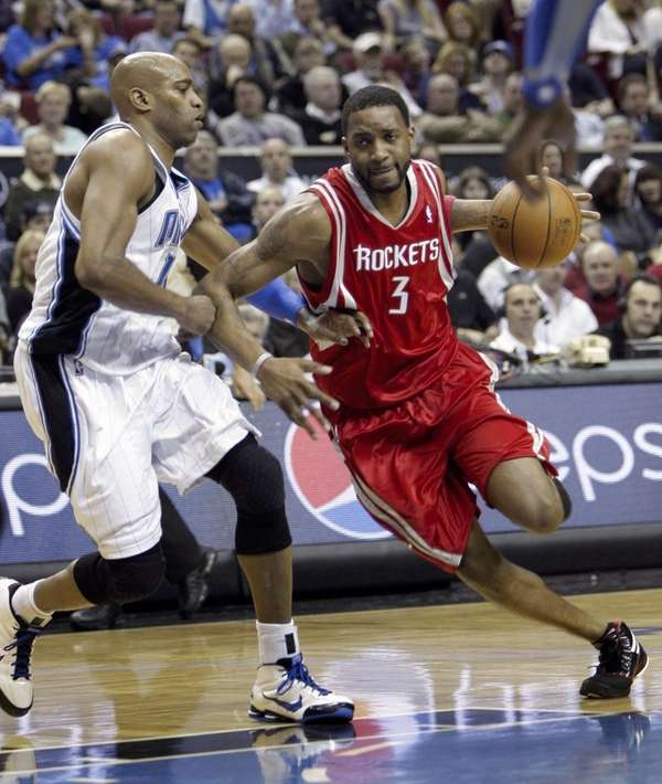 Houston's Tracy McGrady drives against Orlando's Vince Carter.