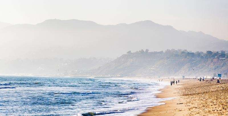 Travelers visiting Santa Monica Beach can soak up
