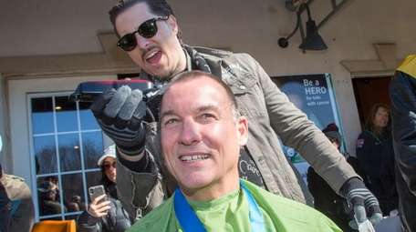Rep. Tom Suozzi has his head shaved at