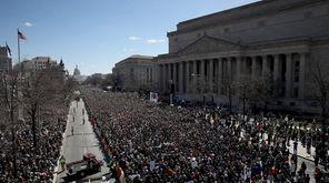 Gun reform advocates line Pennsylvania Avenue at the