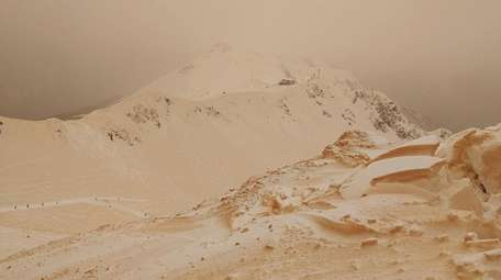 Orange snow is seen on Friday in the