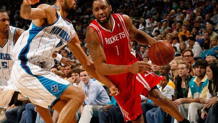 Tracy McGrady #1 of the Houston Rockets drives
