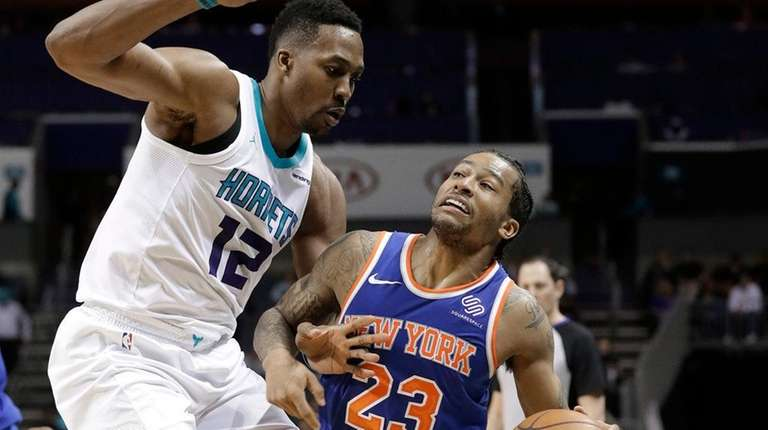 Knicks' Trey Burke (23) is fouled as he