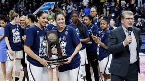 Connecticut's Gabby Williams, left, and Kia Nurse, center,