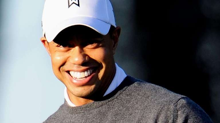 Tiger Woods practices golf outside his home on