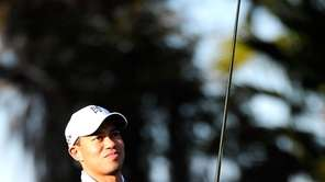 Tiger Woods practices golf outside his home in