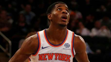 Knicks rookie Damyean Dotson looks on during against