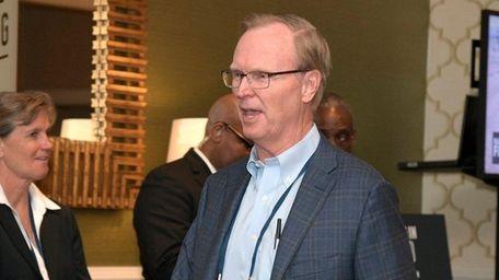 New York Giants owner John Mara leaves a