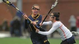 Jaclyn Gatti of Massapequa, left, takes a shot