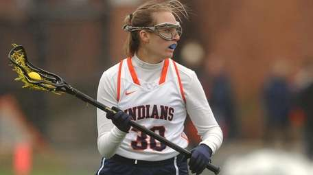 Kelly Trotta of Manhasset carries downfield during a