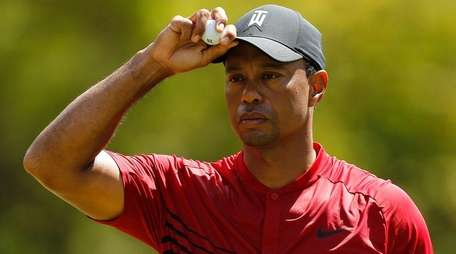 Tiger Woods reacts on the second green during