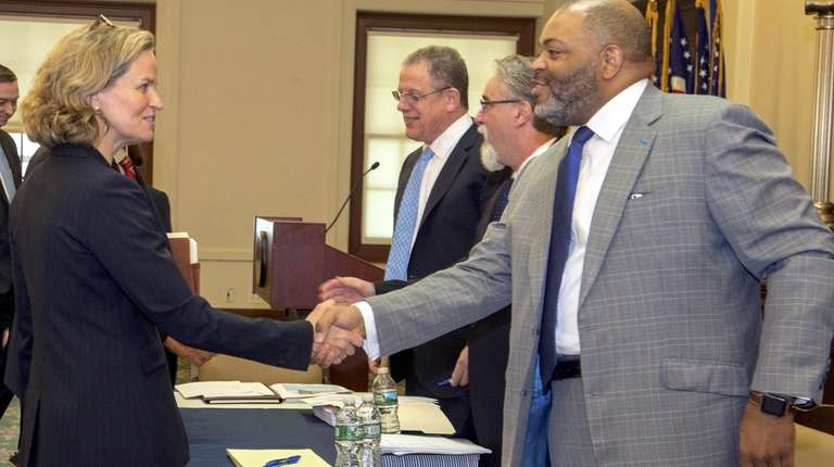 Nassau County Executive Laura Curran shake hands with