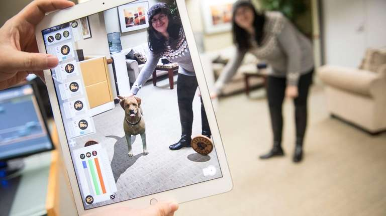 Alyson Adam testing out an augmented reality app