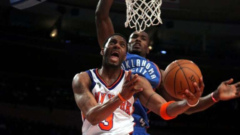 buy popular e5f00 e786b McGrady scores 26 and House gets 24, but Knicks fall in ...