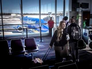 Passengers boarding a Southwest airline headed to West