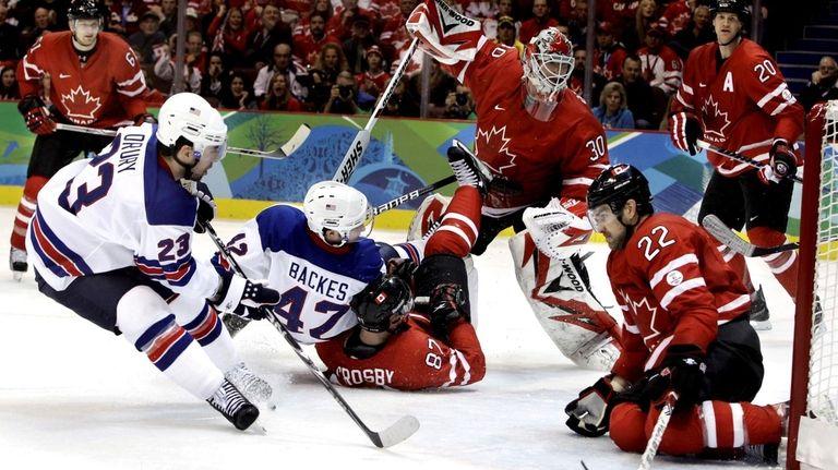 Chris Drury scores past Canada's goalie Martin Brodeur