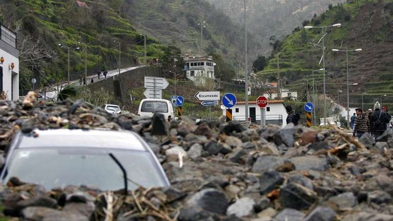 A destroyed car is pictured near Ribeira Brava,