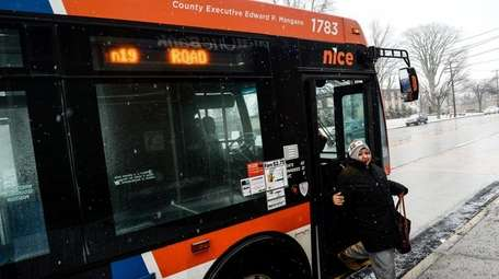 Passengers unload from the N19 NICE bus which