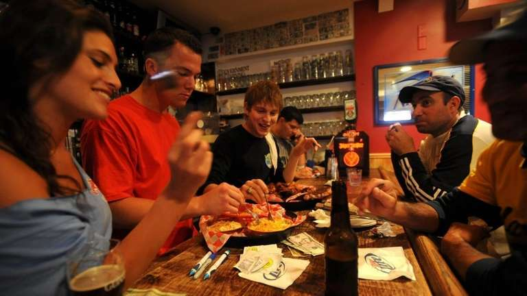 People eat The Challenge at Swingbellys in Long
