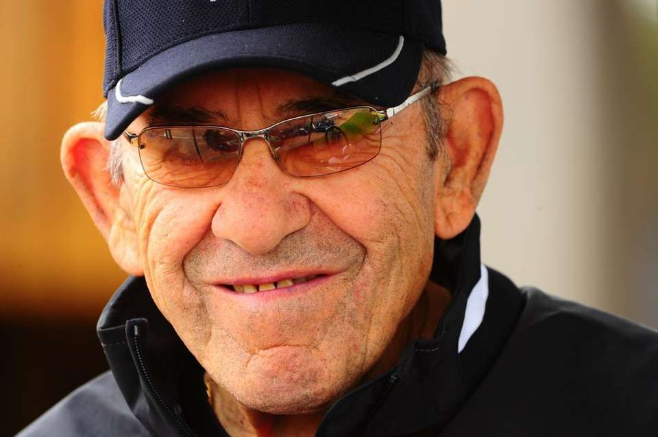 Yogi Berra watches the Yankees during spring training