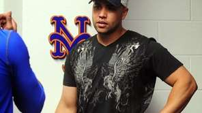 Mets outfielder Carlos Beltran speaks with Jose Reyes