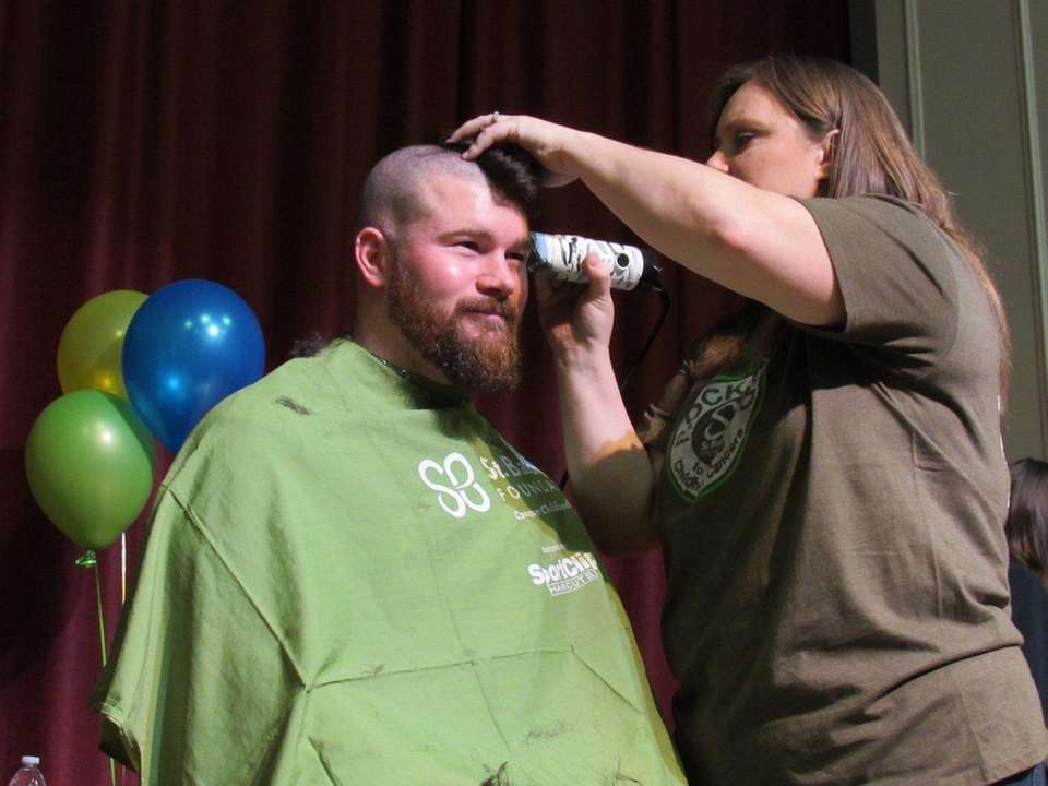 Justin Schimmenti of Patchogue gets his head shaved