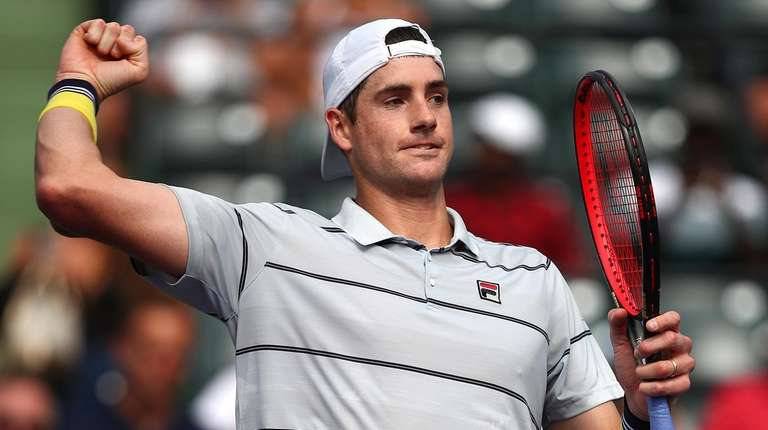 John Isner celebrates after his straight-sets victory against