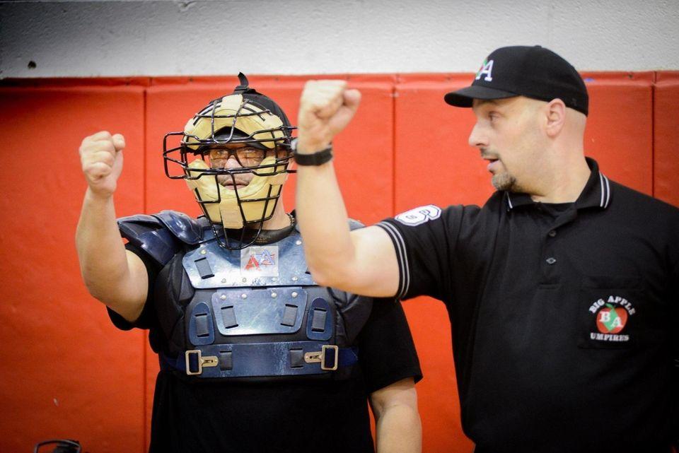 Big Apple Umpire School instructor Steve Callahan, right,