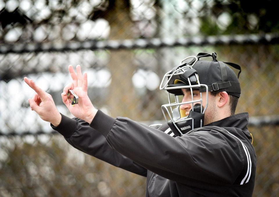 Big Apple Umpire School students Max Braccia, right,