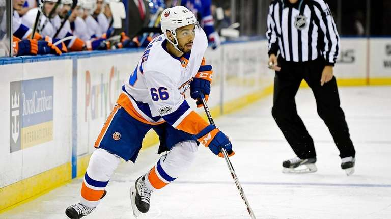 Josh Ho-Sang of the Islanders controls the puck
