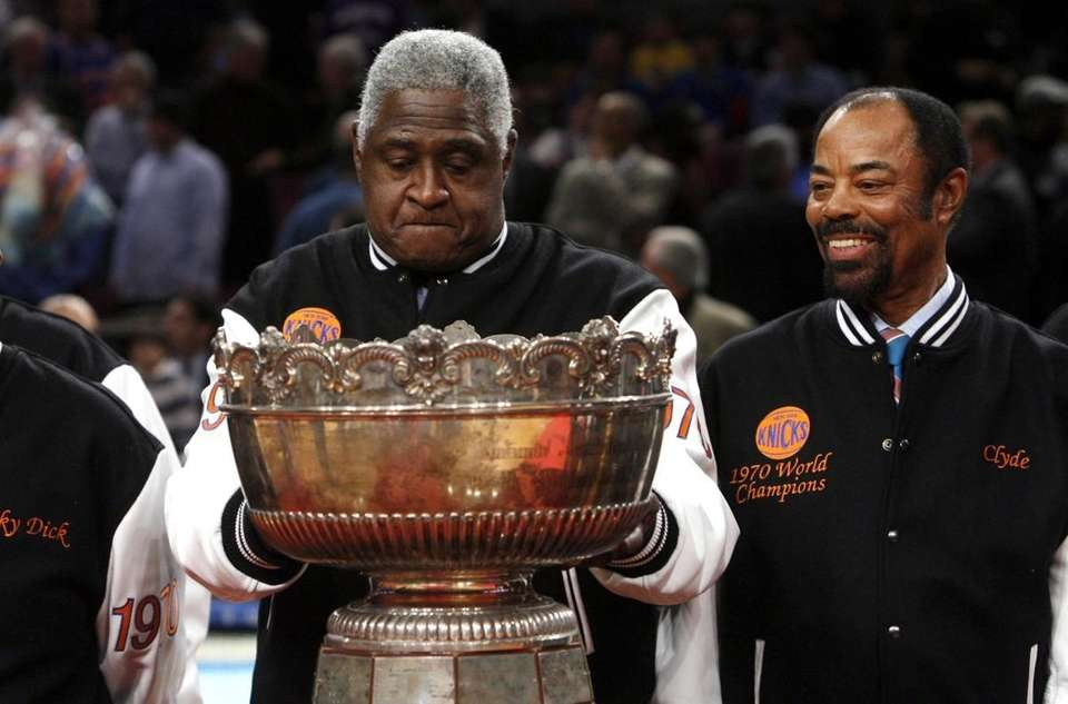 Knicks legend Willis Reed, left, touches the Walter
