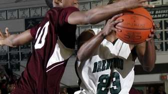 Brentwood's Jean Chery (23) draws the foul from