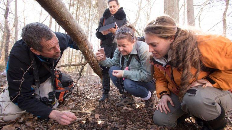 Wildlife biologist Mike Bottini, left, of East Hampton,