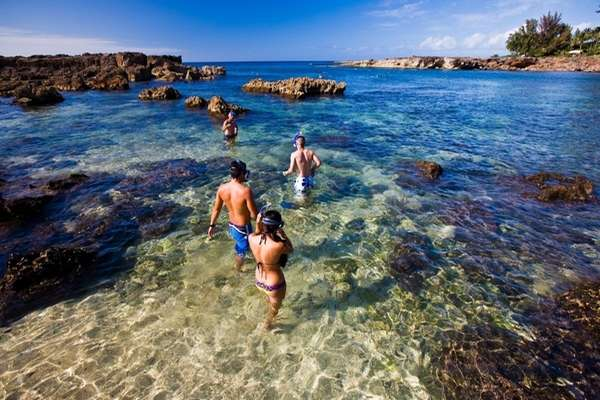Snorkelers enter the water at Pupukea Marine Life