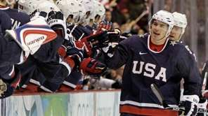 USA's Zach Parise (9) is congratulated after scoring