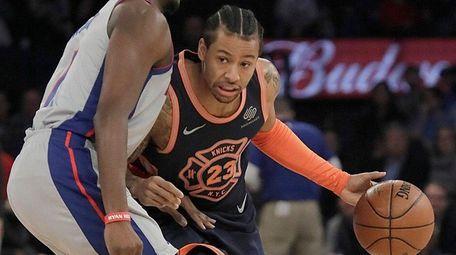Knicks guard Trey Burke drives against Pistons center