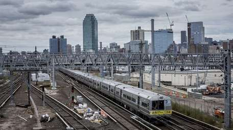A Long Island Rail Road train rolls through