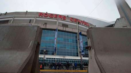 Jersey barriers are shown outside the Rogers Centre