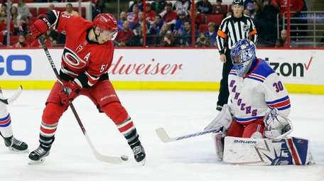 Rangers goalie Henrik Lundqvist blocks the Hurricanes' Jeff