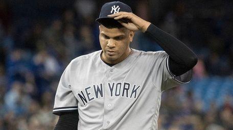 Yankees pitcher Dellin Betances walks off the mound