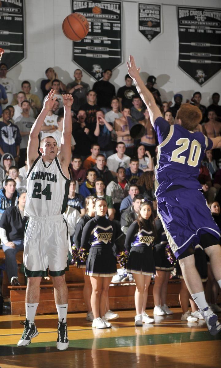 Harborfields' Matt Curry (24) shoots a three pointer