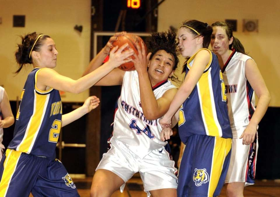 Shneeka Center of Smithtown West, center, is double