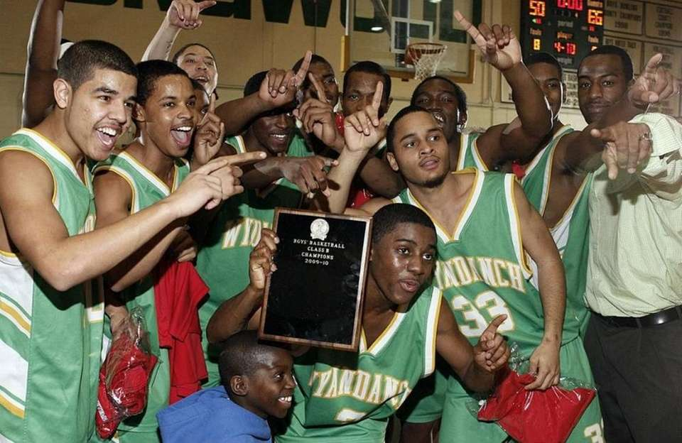 Wyandanch boy basketball team celebrates their victory over