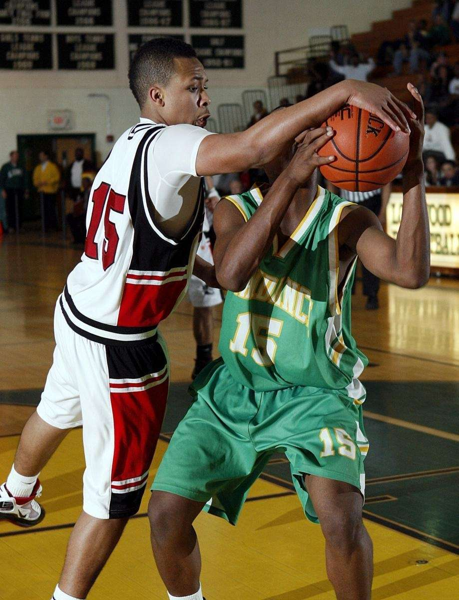 Wyandanch's Donnell Jones (15) draws the foul under