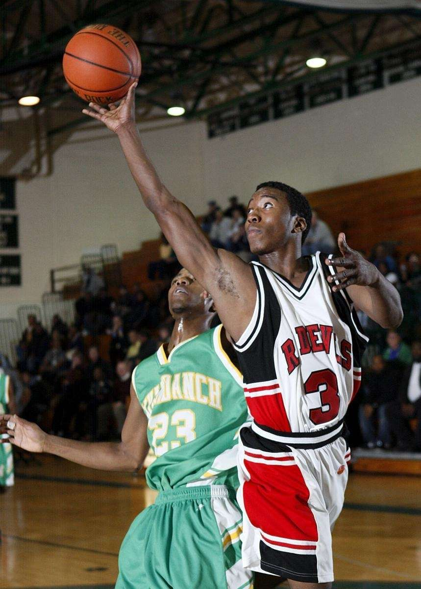 Center Moriches' Myles Bell (3) with the layup