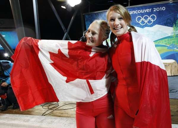 Canada's CAN-1, piloted by Kaillie Humphries, left, and
