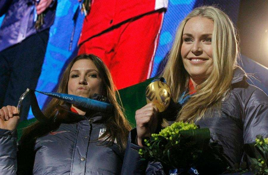 American downhill skiing teammates Julia Mancuso, left, and
